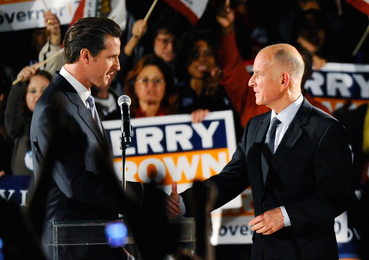 San Francisco Mayor Gavin Newsom, left, introduces Democratic gubernatorial candidate and California Attorney General Jerry Brown at a Democratic National Committee rally on the UCLA campus in October 2010. (Photo: Kevork Djansezian/Getty Images)