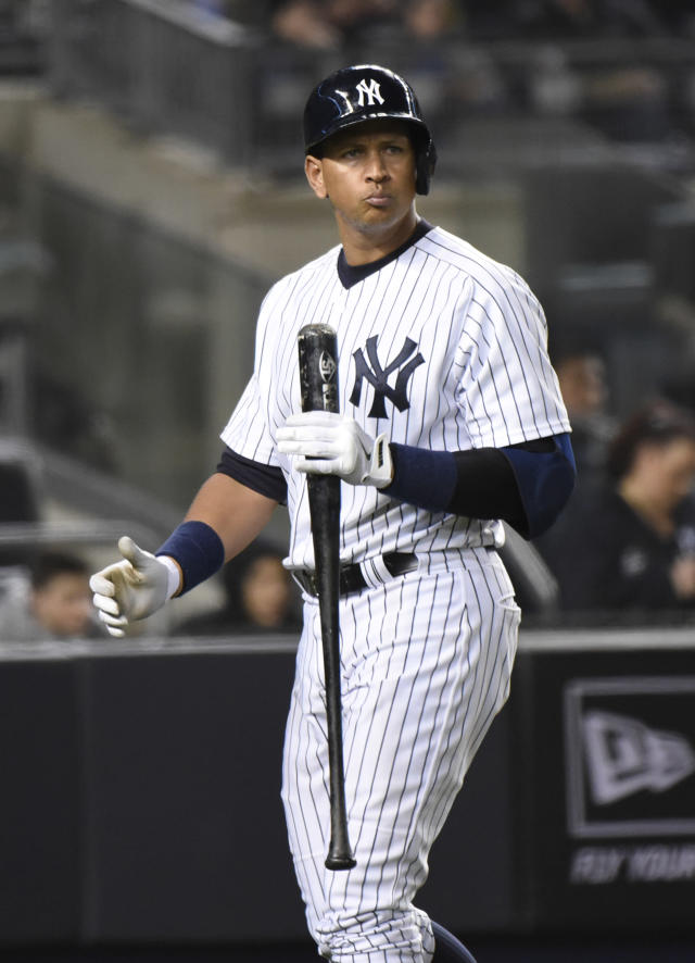 New York Yankees' Alex Rodriguez reacts after striking out during the fourth inning of a baseball game against the Boston Red Sox, Friday, April 10, 2015, at Yankee Stadium in New York. (AP Photo/Bill Kostroun)
