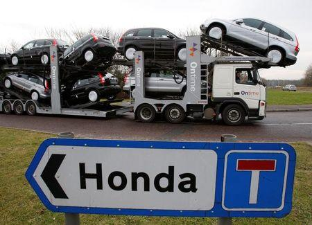 FILE PHOTO: A new car transporter leaves the Honda manufacturing plant in Swindon, western England