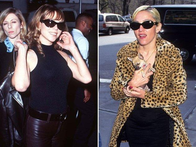 """While in London to promote her 1995 album Daydream, Mariah was asked to respond to alleged verbal attacks from Madonna that said Carey was not """"particularly bright"""" and that the """"Like A Virgin"""" singer would """"rather kill myself than be Mariah."""" Carey appeared to find the question amusing and quipped, """"I really haven't paid much attention to Madonna since I was in the 7th or 8th grade and she used to be popular, so I didn't hear that."""" (photo: S Granitz/WireImage, Tom Wargacki/WireImage)"""