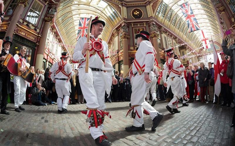 Morris dancers celebrate St George's Day at Leadenhall Market  - Credit: Alamy