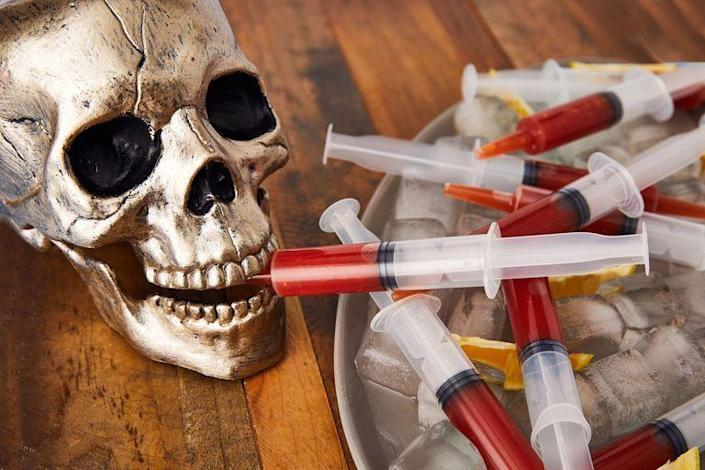 """<p>If your Halloween party is strictly for grown-ups, then have some fun with these alcoholic shots. </p><p><strong><em>Get the recipe at <a href=""""https://www.delish.com/cooking/recipe-ideas/a24132876/bloody-mary-syringes-recipe/"""" rel=""""nofollow noopener"""" target=""""_blank"""" data-ylk=""""slk:Delish"""" class=""""link rapid-noclick-resp"""">Delish</a>. </em></strong></p>"""