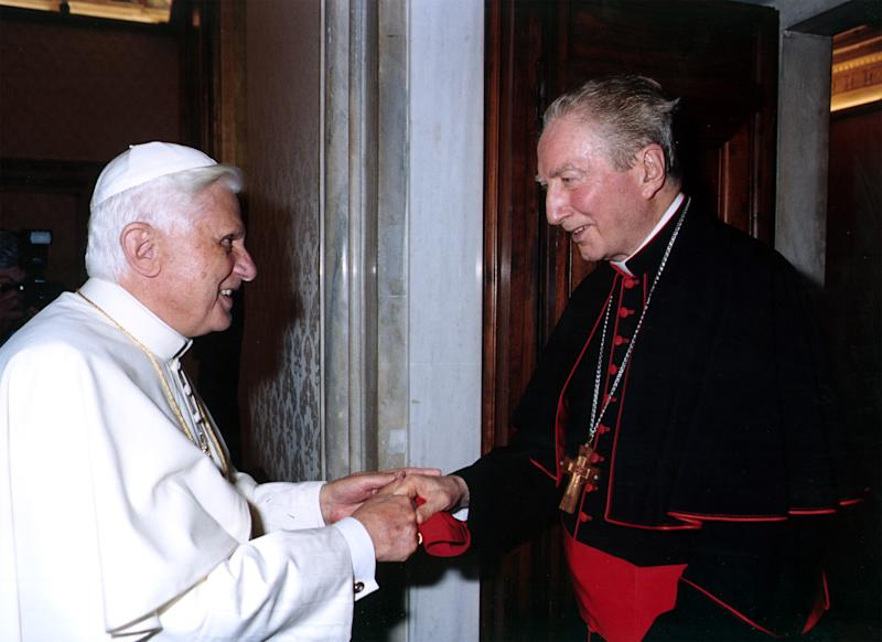"FILE - In this May 27, 2005 file photo released by the Vatican paper L'Osservatore Romano Pope Benedict XVI greets Cardinal Carlo Maria Martini at the Vatican. Pope have punished Jesuits theologians for being too progressive in preaching and teaching. The last pontiff, Benedict, politely but firmly sent a letter to the Jesuit's leader inviting members to pledge ""total adhesion"" to Catholic doctrine, including on divorce, homosexuality and liberation theology. Now the pope is a Jesuit, the first ever from the missionary order's well-educated and savvy ranks in its nearly 500-year-long history, and Francis just heard the church cardinals pledge allegiance to him. Cardinal Carlo Maria Martini in a interview published shortly after he died last year called for radical change in the Vatican, lamenting the church was 200 years behind the times. (AP Photo/L'Osservatore Romano)"