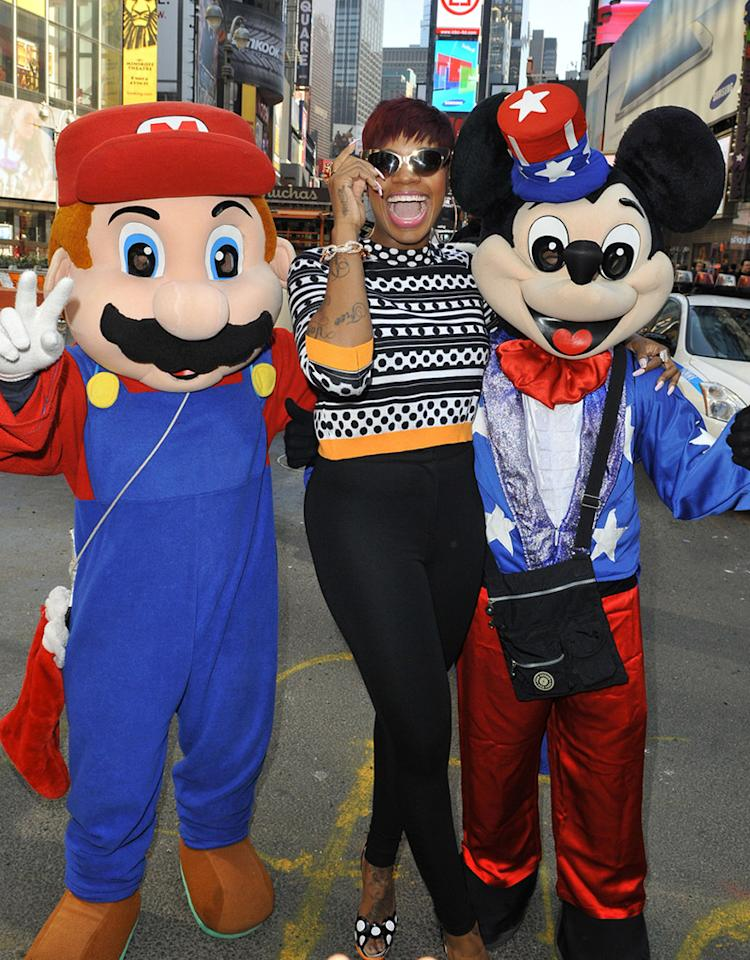 "Speaking of excitement, ""American Idol"" champ Fantasia looked thrilled to get the chance to hang out with Super Mario and Mickey Mouse in New York's Times Square on Wednesday. She was there to sing her new tune ""Lose to Win"" on ""Good Morning America."" (4/24/2013)"