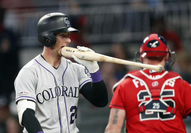 Colorado Rockies' Ryan McMahon (24) bites his bat after striking out in the sixth inning of a baseball game against the Atlanta Braves, Friday, April 26, 2019, in Atlanta.(AP Photo/John Bazemore)