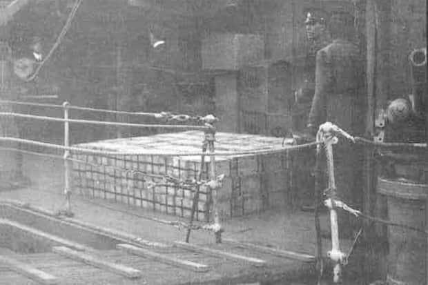 This rare photograph shows gold bullion stacked on the deck of HMS Emerald in late June 1940, bound for the Bank of Canada's vault in Ottawa. At the time, it was part of the single-largest transfer of material wealth in history. (Imperial War Museum - image credit)