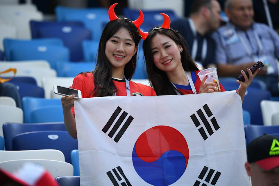 <p>South Korea supporters wave the national flag ahead of the Russia 2018 World Cup Group F football match between Sweden and South Korea at the Nizhny Novgorod Stadium in Nizhny Novgorod on June 18, 2018. (Photo by Johannes EISELE / AFP) </p>