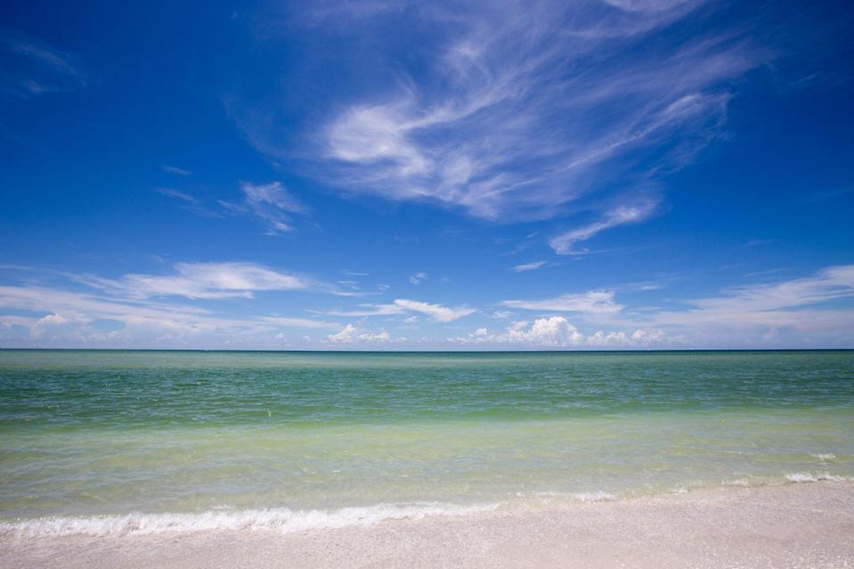 """<p>A barrier island located off the coast of Marco Island and Naples, <a href=""""https://www.paradisecoast.com/profile/keewaydin-island/984"""" rel=""""nofollow noopener"""" target=""""_blank"""" data-ylk=""""slk:Keewaydin Island"""" class=""""link rapid-noclick-resp"""">Keewaydin Island</a> is a hidden gem. It's a hotspot on the weekends for in-the-know locals, but most beach connoisseurs don't even know this pristine seven-mile stretch of sand exists. There are no roads, cars, or bridges, so you're going to need a boat. Wildlife abounds, especially loggerhead sea turtles, wild boars, and bobcats. It's also home to the <a href=""""https://rookerybay.org/"""" rel=""""nofollow noopener"""" target=""""_blank"""" data-ylk=""""slk:Rookery Bay National Estuarine Research Reserve,"""" class=""""link rapid-noclick-resp"""">Rookery Bay National Estuarine Research Reserve,</a> one of the few remaining undisturbed mangrove estuaries in North America.</p>"""