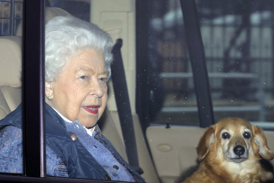 Britain's Queen Elizabeth leaves Buckingham Palace for Windsor Castle to socially distance herself amid the coronavirus pandemic, in London, Thursday, March 19, 2020. She is heading to her Berkshire home a week earlier than she normally would at this time of year, and is expected to remain there beyond the Easter period. For some people the new COVID-19 coronavirus causes only mild or moderate symptoms, but for some it can cause severe illness.  (Aaron Chown/PA via AP)