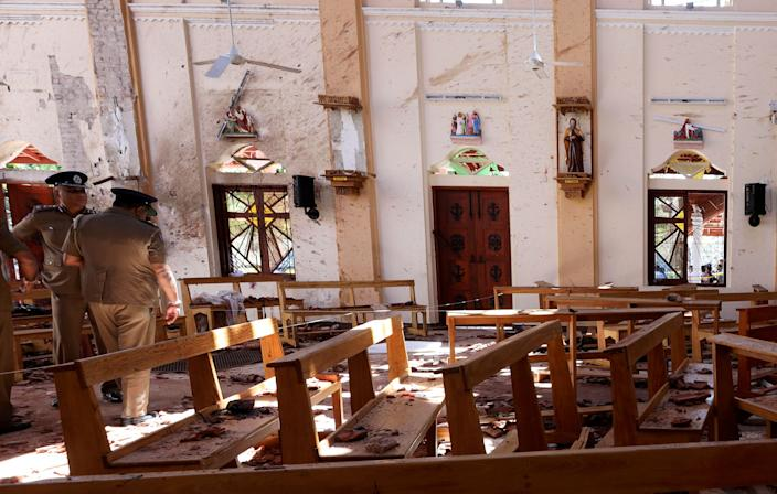 Police officers work at the scene at St. Sebastian Catholic Church, after bomb blasts ripped through churches and luxury hotels on Easter, in Negombo, Sri Lanka April 22, 2019. (Photo: Athit Perawongmetha/Reuters)