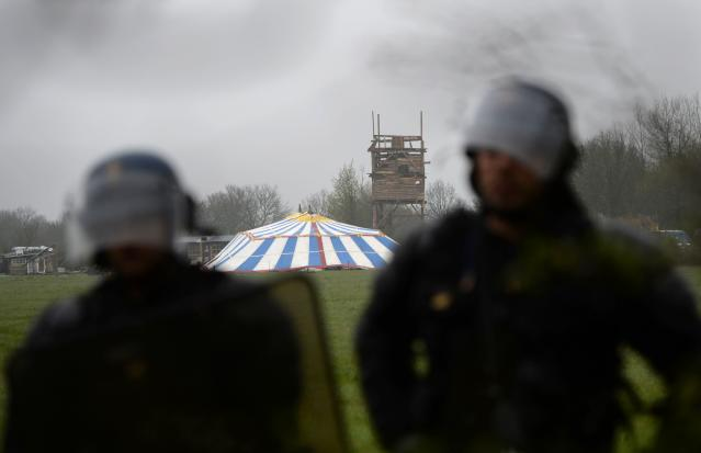 "<p>Riot police officers stand guard as they protect the place named ""Le Lama Fache"" in the ZAD (Zone a Defendre – Zone to defend) in Notre-Dame-des-Landes, western France. (Photo: Guillaume Souvant/AFP/Getty Images) </p>"