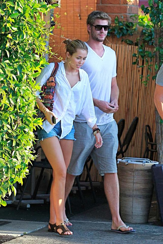 """Hollywood Life reports that Miley Cyrus and Liam Hemsworth are """"living together."""" Not only are they """"as hot and heavy as ever,"""" but """"Liam has been staying with Miley,"""" reiterated the website. For all the dish about them shacking up, read what a Cyrus insider exclusively tells <a href=""""http://www.gossipcop.com/miley-cyrus-liam-hemsworth-living-together-sharing-shacking-house-home/"""" target=""""new"""">Gossip Cop</a>. BOA/<a href=""""http://www.splashnewsonline.com"""" target=""""new"""">Splash News</a> - July 14, 2010"""