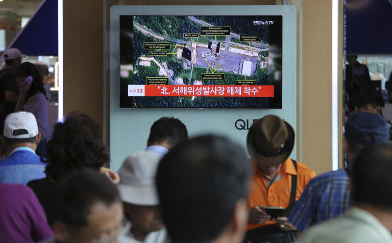 A TV screen shows a satellite image of North Korea's Sohae launch site during a news program at the Seoul Railway Station in Seoul South Kore Tuesday