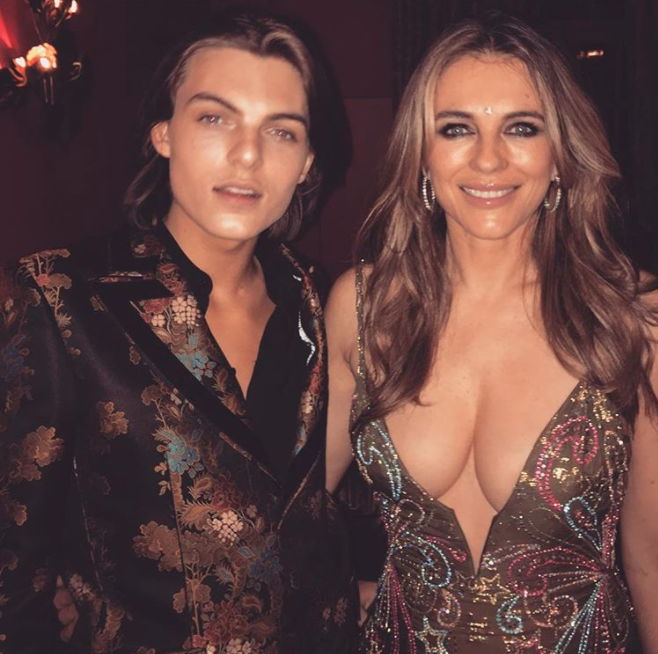 Liz and son, Damian, at his 16th birthday. Liz was also in the media for this revealing dress. Source: Instagram/elizabethhurley1
