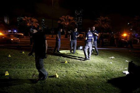 Israeli police search the spot where, according to Israeli police spokesperson, at least 10 Israelis were stabbed, in the popular Jaffa port area of Tel Aviv, Israel March 8, 2016. REUTERS/Amir Cohen