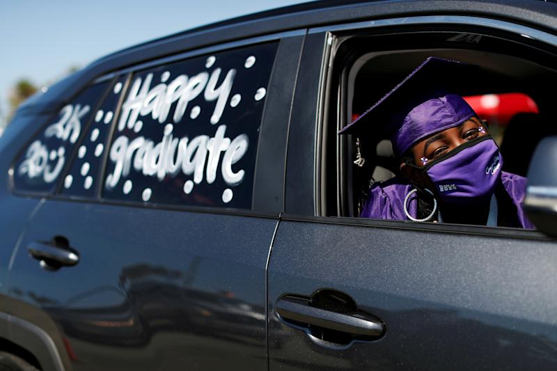 Compton Early College High School graduating student Makayla Moore poses in her car in a parking lot during a drive-thru graduating ceremony, during the outbreak of the coronavirus disease (COVID-19) in Compton, California U.S. June 10, 2020. REUTERS/Mario Anzuoni TPX IMAGES OF THE DAY
