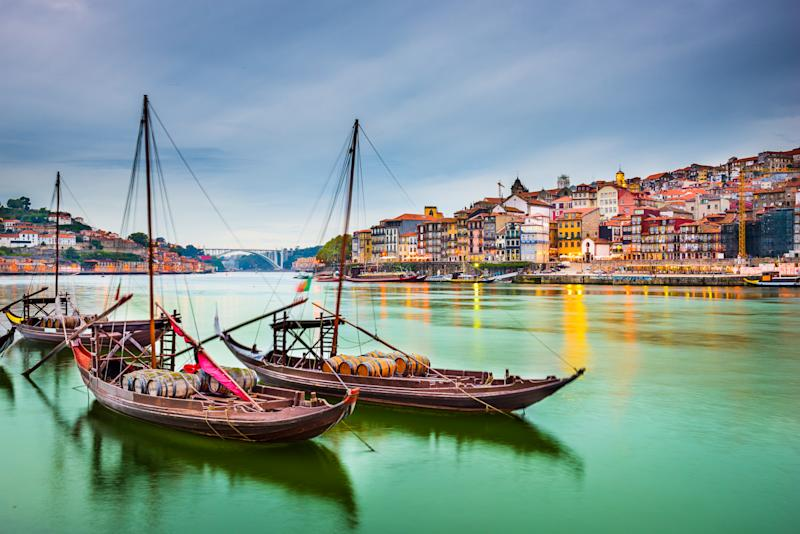 Porto, Portugal old town cityscape on the Douro River with traditional Rabelo boats. Photo: Getty