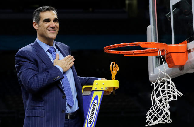 Villanova head coach Jay Wright reacts after cutting down the net after beating Michigan 79-62 in the championship game of the Final Four NCAA college basketball tournament, Monday, April 2, 2018, in San Antonio. (AP Photo/David J. Phillip)
