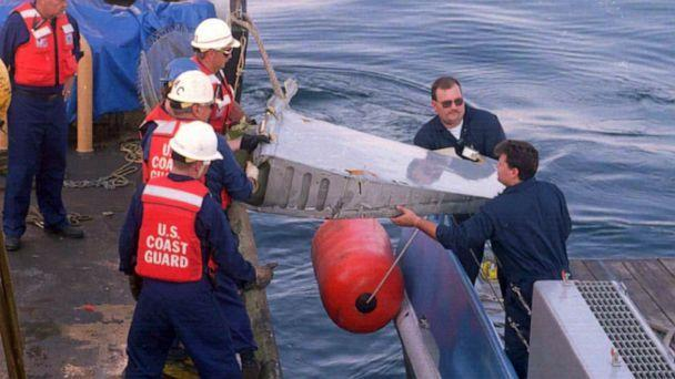 PHOTO: U.S. Coast Guard crewmen collect parts of the TWA jetliner from the waters off Long Island's south shore, July 18, 1996. (Adam Nadel/AFP via Getty Images, FILE)