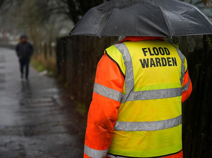 Volunteer flood warden Keith Crabtree MBE checks flooding on train tracks in Todmorden, West YorkshireChristopher Furlong/Getty Images