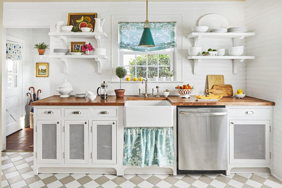 <p>You know that fabric you've been in love with forever? Create a Roman shade and a sink skirt and make that all-white kitchen really sing. We also love the subtle take on a checkerboard floor, shown here with beige and white tiles laid diagonally.</p>