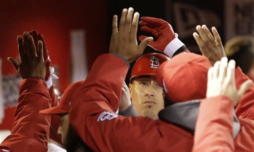 St. Louis Cardinals' Allen Craig is congratulated after his sacrifice fly ball to score Matt Carpenter from third during the first inning of Game 4 of baseball's National League championship series against the San Francisco Giants Thursday, Oct. 18, 2012, in St. Louis. (AP Photo/David J. Phillip)
