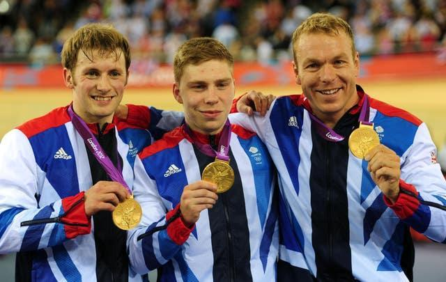 Hoy, right, Jason Kenny, left, and Philip Hindes proudly display their team sprint gold medals