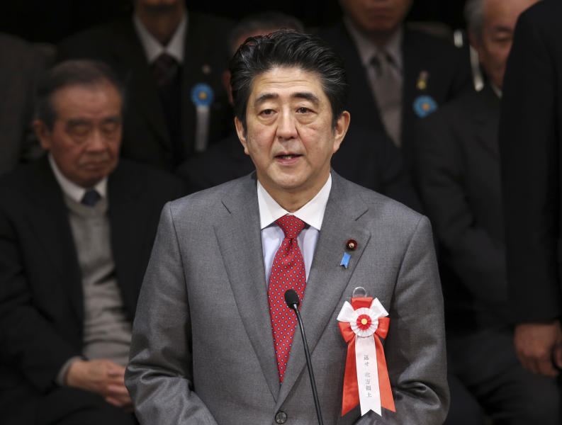 """Japanese Prime Minister Shinzo Abe delivers his speech during a national rally to demand the return of Russian-held four islands floating off the northernmost main island of Hokkaido, in Tokyo, Friday, Feb. 7, 2014, Japan has designated Feb. 7 as """"Northern Territories Day. Abe and his Chinese counterpart appear not to be bothered by the international ruckus over Russia's law restricting gay rights. Unlike President Barack Obama, who pointedly declined to attend the Winter Olympics, the leaders of the world's second and third largest economies — where gay rights are not a hot-button political issue — are going to Sochi. (AP Photo/Koji Sasahara)"""