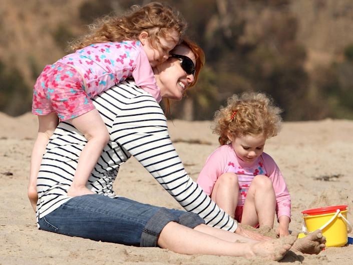 marcia cross on the beach with twin daughters in 2010