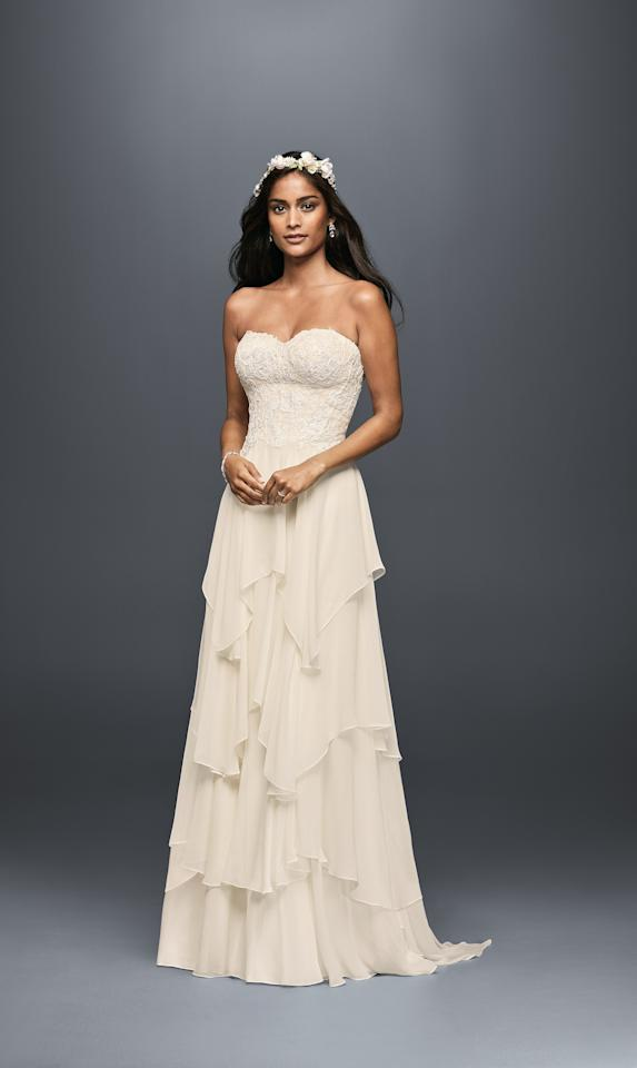 "<p><em>Style MS251178, tiered chiffon a-line wedding dress, $758, Melissa Sweet available at <a rel=""nofollow"" href=""http://www.davidsbridal.com/?mbid=synd_yahoostyle"">David's Bridal</a></em></p>"