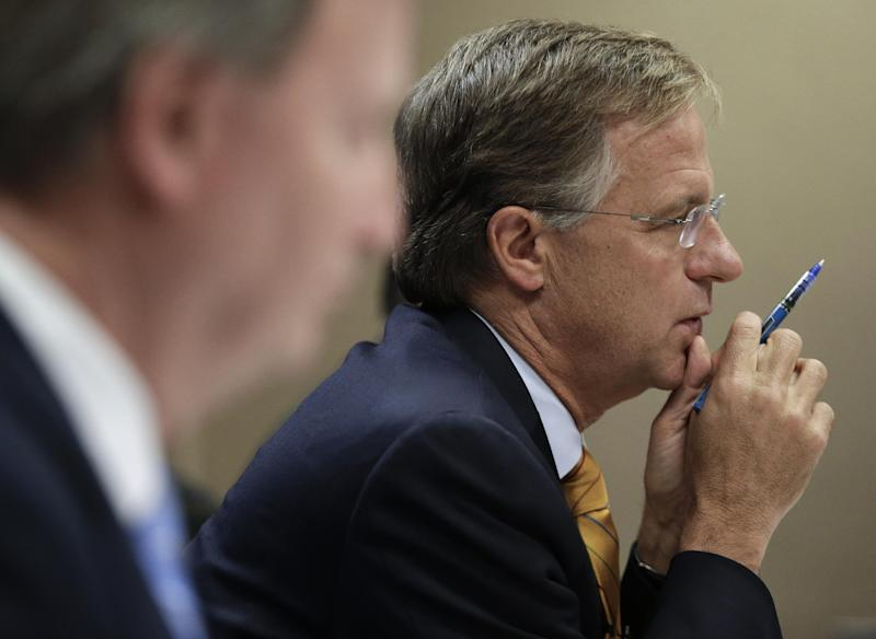 Tennessee Gov. Bill Haslam, right, listens to a presentation by the Department of Children's Services during budget hearings on Thursday, Nov. 8, 2012, in Nashville, Tenn. Haslam has asked state departments to develop plans for a 5 percent spending cut. (AP Photo/Mark Humphrey)