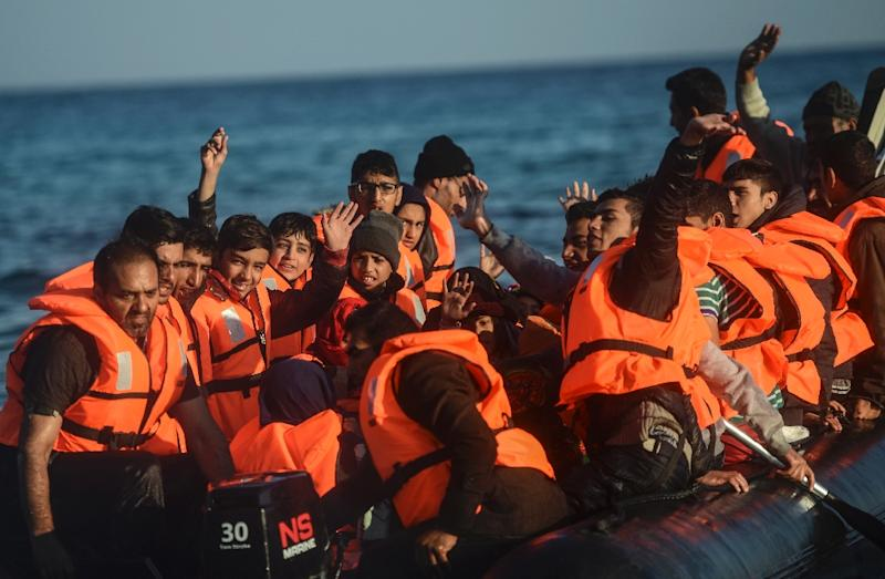 Migrants in a raft disembark on the Greek island of Chios on November 5, 2015 after travelling from Cesme in Turkey (AFP Photo/Bulent Kilic)
