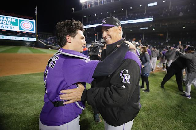 Tony Wolters celebrates with manager Bud Black after the Rockies' NL wild-card win. (Getty Images)