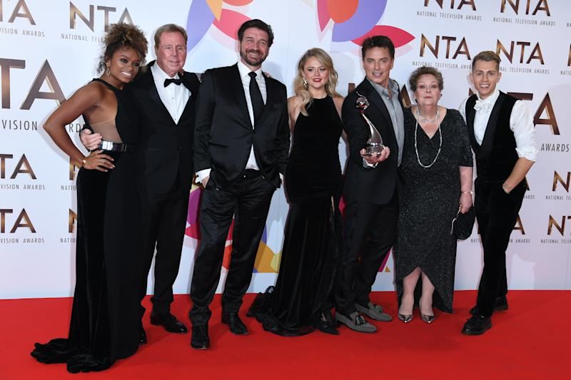 Fleur East, Harry Redknapp, Nick Knowles, Emily Atack, John Barrowman, Anne Hegerty, James McVey, and Scarlett Moffatt with the Bruce Forsyth award for Entertainment in the Press Room at the National Television Awards 2019 held at the O2 Arena, London. Photo credit should read: Doug Peters/EMPICS
