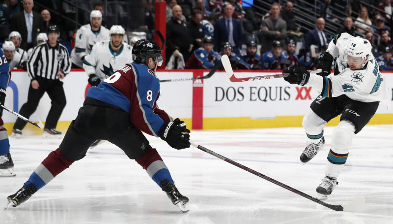 San Jose Sharks center Tomas Hertl, right, fires a shot past Colorado Avalanche defenseman Cale Makar during the second period of an NHL hockey game Thursday, Jan. 16, 2020, in Denver. (AP Photo/David Zalubowski)