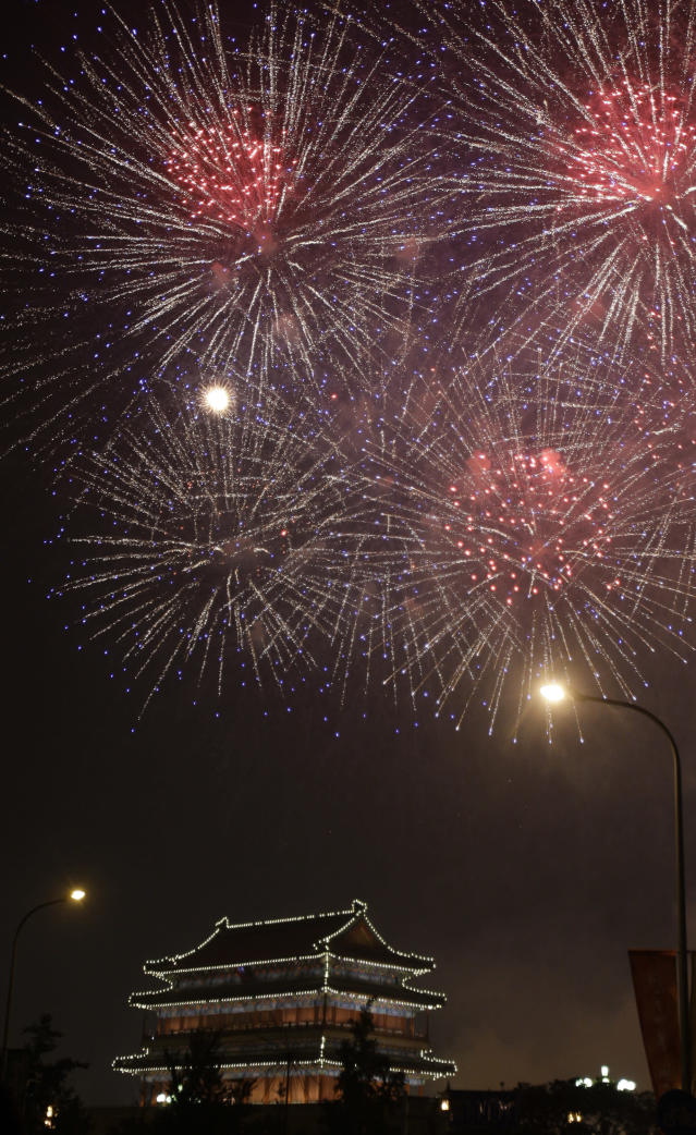 Fireworks burst over an ancient gate of Beijing near Tiananmen Square as part of the Opening Ceremony of the Beijing 2008 Olympics in Beijing, Friday, Aug. 8, 2008. (AP Photo/Charles Krupa)