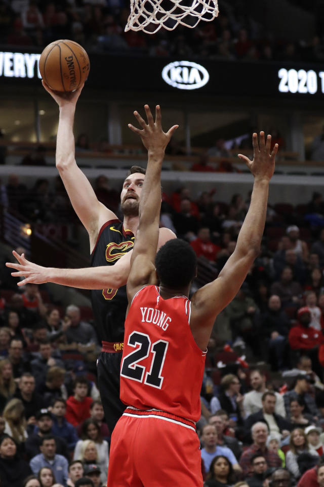 Cleveland Cavaliers forward Kevin Love, left, shoots next to Chicago Bulls forward Thaddeus Young during the second half of an NBA basketball game in Chicago, Saturday, Jan. 18, 2020. (AP Photo/Nam Y. Huh)