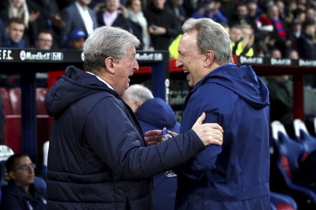Crystal Palace manager Roy Hodgson, left and Cardiff City manager Neil Warnock react prior to the start of the English Premier League soccer match between Crystal Palace and Cardiff City at Selhurst Park, in London, Wednesday Dec. 26, 2018. (Yui Mok/PA via AP)