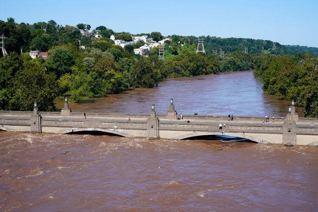 The Schuylkill River exceeds its bank in the Manayunk section of Philadelphia on Thursday in the aftermath of downpours and high winds from the remnants of Hurricane Ida. (Photo: via Associated Press)