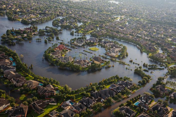 <p>Flood water surrounds homes in a residential neighborhood in the wake of Hurricane Harvey on August 29, 2017 in Houston, Texas. (Photo: Marcus Yam / Los Angeles Times via Getty Images) </p>