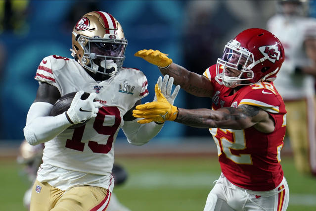 Kansas City Chiefs strong safety Tyrann Mathieu, right, reaches to tackle San Francisco 49ers wide receiver Deebo Samuel during the first half of the NFL Super Bowl 54 football game Sunday, Feb. 2, 2020, in Miami Gardens, Fla. (AP Photo/David J. Phillip)
