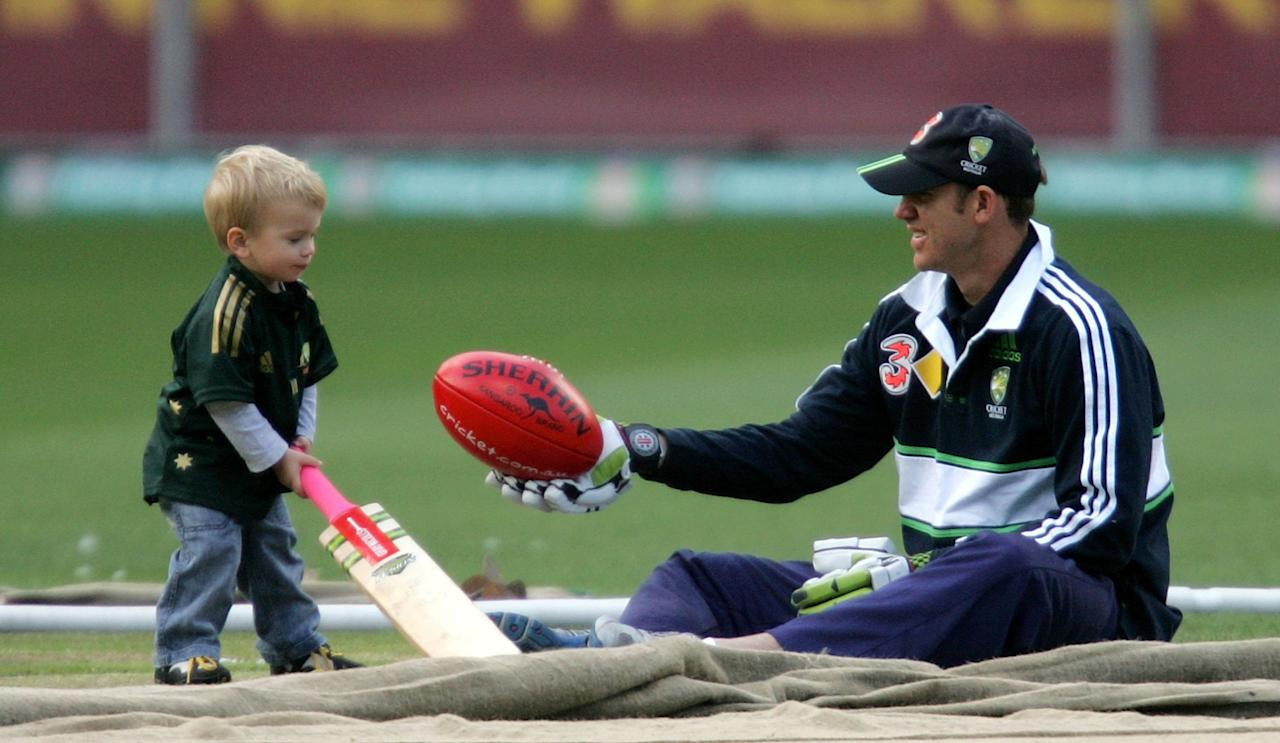 MELBOURNE, AUSTRALIA - DECEMBER 25:   Matthew Hayden of Australia sits with his son Josh (23 months) in the middle of the MCG during an Australian nets session at the Melbourne Cricket Ground on December 25, 2006 in Melbourne, Australia.  (Photo by Aaron Francis/Getty Images)