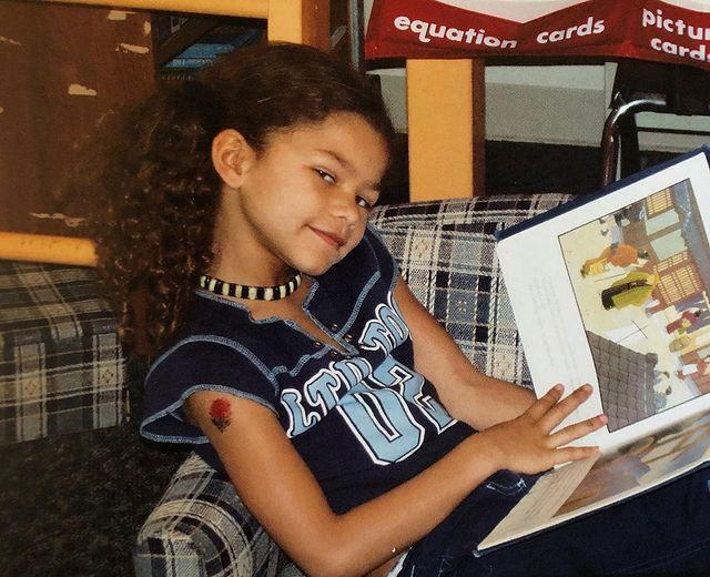 """<p>To mark her 23rd birthday, the Euphoria star shared an adorable TBT of her reading as a child. Happy birthday, Zendaya!</p><p><a href=""""https://www.instagram.com/p/B15iRtVgRbx/"""" rel=""""nofollow noopener"""" target=""""_blank"""" data-ylk=""""slk:See the original post on Instagram"""" class=""""link rapid-noclick-resp"""">See the original post on Instagram</a></p>"""