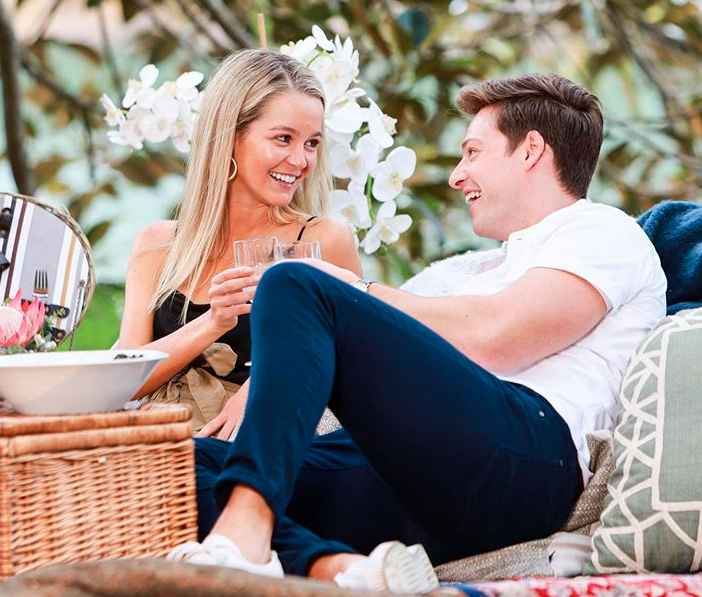 Helena Sauzier and Matt Agnew recline on the set of The Bachelor Australia 2019