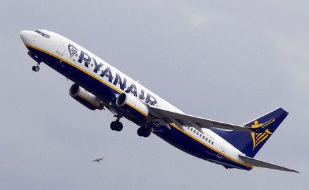 FILE PHOTO: Ryanair commercial passenger jet takes off in Colomiers near Toulouse