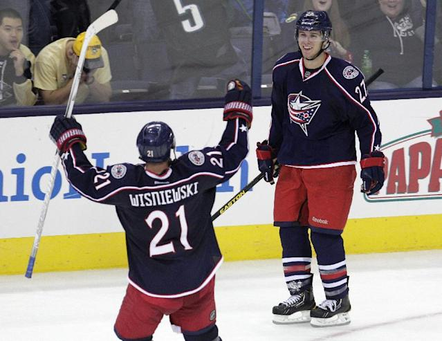 Columbus Blue Jackets' Ryan Murray, right, celebrates his game-winning goal against the Pittsburgh Penguins with teammate James Wisniewski during the overtime period of an NHL preseason hockey game, Sunday, Sept. 15, 2013, in Columbus, Ohio. The Blue Jackets beat the Penguins 5-4. (AP Photo/Jay LaPrete)