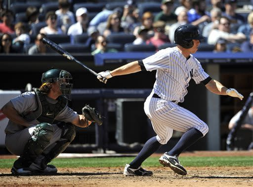 New York Yankees' Brett Gardner hits an RBI single off in Oakland Athletics relief pitcher Chris Resop in the seventh inning of a baseball game at Yankee Stadium on Saturday, May 4, 2013 in New York. (AP Photo/Kathy Kmonicek)