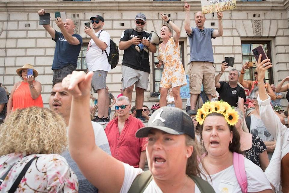 Anti-vaccination protesters during a demonstration in London in July (Jonathan Brady/PA) (PA Wire)