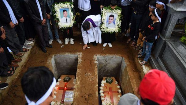 PHOTO: A priest officiates final rites during burial of coffins bearing the remains of two Vietnamese migrants at a cemetery in Dien Chau district, Nghe An province on Nov. 28, 2019. (Nhac Nguyen/AFP via Getty Images, FILE)