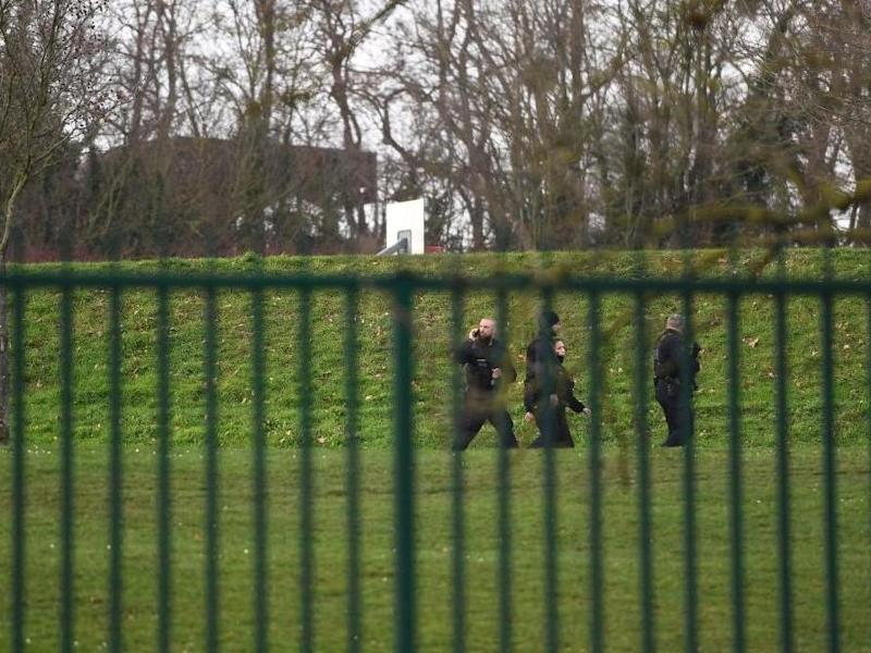 Police officers patrol in a park near Villejuif on 3 January, 2020 where a man was shot and killed by officers after stabbing passers-by: AFP via Getty Images
